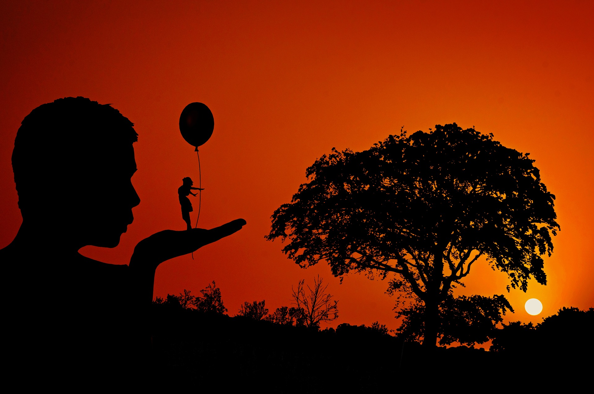 Mann pustet gegen eine kleine Frau, die an einem Luftballon hängt um sie fliegen zu lassen. Weg mit dem Perfektionismus.
